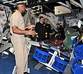 US Navy 091204-N-8848T-799 Chief Boatswain's Mate Donald Walker shows a bomb damaged berthing compartment on the Arleigh Burke-class destroyer simulator, USS Trayer (BST 21).jpg