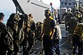 US Navy 100201-N-9418A-131 Senior Chief Boatswain's Mate Derrick Henry, leading chief petty officer of the deck department, counts Marines as they board a landing craft utility.jpg