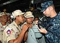 US Navy 101026-N-9156C-003 Quartermaster 2nd Class John Ostgard explains navigation equipment on the bridge of the guided-missile frigate USS Cromm.jpg