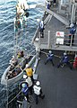 US Navy 101218-N-3415O-030 Sailors assigned to the guided-missile cruiser USS Lake Champlain (CG 57) recover a rigid-hull inflatable boat during an.jpg