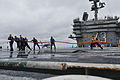US Navy 110322-N-9643S-082 Sailors aboard the aircraft carrier USS George Washington (CVN 73) scrub the flight deck during a counter-measure wash d.jpg