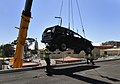 US Navy 110822-N-JD259-008 A crane places an SUV on the deck of the USS Carl Vinson.jpg