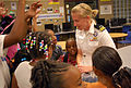 US Navy 110908-N-CI293-077 Lt. Katy Gelenter, an officer recruiter assigned to Navy Recruiting District Omaha, answers questions from girls at the.jpg