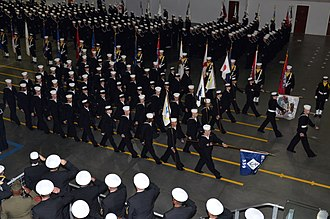 Recruit training - US Navy recruits complete their initial training with a graduation parade, 2011.