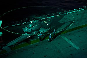 US Navy 111230-N-DX615-140 Sailors conduct a hot refueling of an AH-1W Cobra attack helicopter during night flight operations aboard the amphibious.jpg