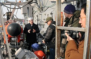 US Navy 120210-N-MU720-015 Mineman Seaman Bryan Surber, assigned to the mine countermeasures ship USS Patriot (MCM 7), talks to local media about t.jpg