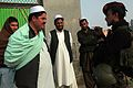 Villagers talk to a commando, right, from the Afghan National Army, 5th Commando Kandak, during a shura held in Pul-e Khumri district, Baghlan province, Afghanistan, Feb 120210-A-BT925-007.jpg