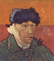 Portrait of a clean shaven man wearing a furry winter hat and smoking a pipe; facing to the right with a bandaged right ear