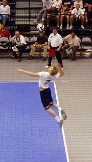 A man making a jump serve.