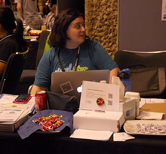 WMF Community Advocacy and Engagement stand at the Wikimania 2014 communities village at 16-40 on Friday 02.jpg