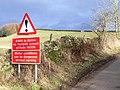 Warning sign and farmland near Renwick - geograph.org.uk - 119593.jpg