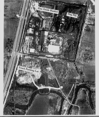 Chemetco - U.S. Government aerial photo, 1998. Chemetco's illegal waste can be seen as a silvery boomerang-shaped curve underneath the truck parking lot. This is where the secret pipe emerged.