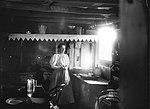 Woman inside a settler's hut (2376883506).jpg