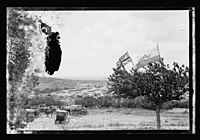 Zionist and British flags flying over an Arab village LOC matpc.22553.jpg