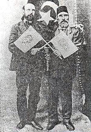 Yane Sandanski - Yane Sandanski, posing in front of Ottoman flag with Young Turks activist Nurredin Beg.