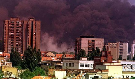Smoke rising in Novi Sad, Serbia after NATO bombardment in 1999 Nato bombe izazivale ekoloshku katastrofu u Novom Sadu.jpeg