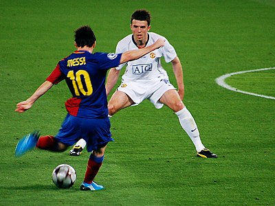 Lionel Messi has been a leading exponent of the false 9 position. 039 men at work UEFA 2009, Rome.jpg