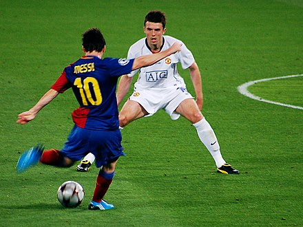 Messi aiming to shoot during the Champions League final against Manchester United in May 2009 039 men at work UEFA 2009, Rome.jpg
