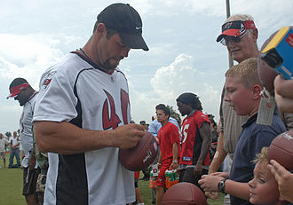 Mike Alstott - Alstott signing autographs as a member of the Buccaneers in 2006.