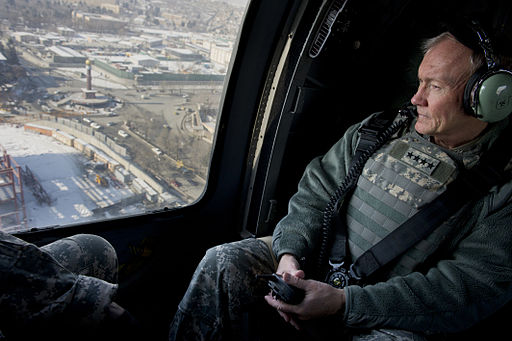 120209-D-VO565-002 - Martin E. Dempsey looks through the window of a UH-60 Blackhawk helicopter while flying over Kabul