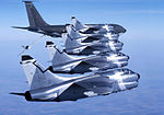 124th Tactical Fighter Squadron A-7D Corsair IIs in formation with KC-135.jpg