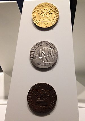 Gold medal - The gold, silver and bronze medals of the 1964 Olympic Winter Games (Olympic Museum).