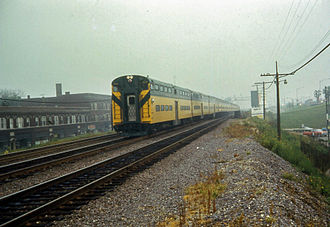 Chicago and North Western Transportation Company - A cab car leads an inbound Northwest Line train through Irving Park. Most commuter rail lines in Chicago, including today's Metra, used cars of this design.