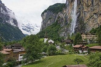 Lauterbrunnen - The Lauterbrunnen Valley: The village of Lauterbrunnen, the Staubbach Fall, and the Lauterbrunnen Wall in cloud (background)