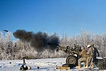 2-377 Parachute Field Artillery M119 crew fires howitzer at Joint Base Elmendorf-Richardson US Army 190110-A-DU810-415.jpg