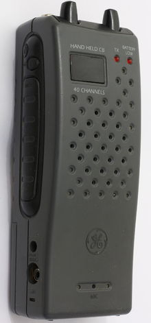 Close-up of gray walkie-talkie CB radio, viewed from the side