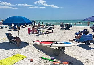 Standup paddleboarding - paddleboard and paddle on the beach at Siesta Key