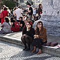 25 April 2018 - Celebrating the 1974 Carnation Revolution - Two girls relaxing and eating after the demonstration (43594008351).jpg