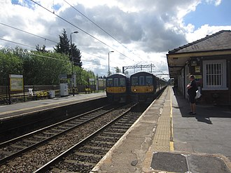 St Helens Junction railway station - Image: 319 Airport and 319 Man Vic