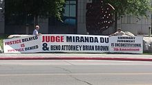 Judge Miranda Du and Reno lawyer Brian Brown protest