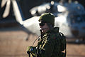 A Canadian soldier with 2nd Battalion, Royal Newfoundland Regiment, 37th Canadian Brigade Group, waits to load an MH-60 Seahawk helicopter during Exercise Southern Raider 13, at Fort Pickett, Va., March 4, 2013 130304-A-KH856-033.jpg