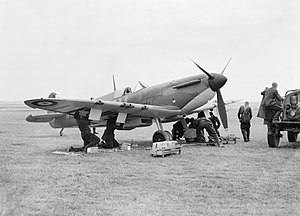 RAF Fowlmere - A Supermarine Spitfire Mk 1 of No. 19 Squadron RAF being re-armed between sorties at Fowlmere, near Duxford, September 1940.
