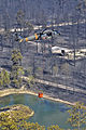 A U.S. Army UH-60 Black Hawk helicopter assigned to the Colorado Army National Guard picks up water for a water drop while fighting the Black Forest Fire near Colorado Springs, Colo., June 12, 2013 130612-Z-UA373-496.jpg
