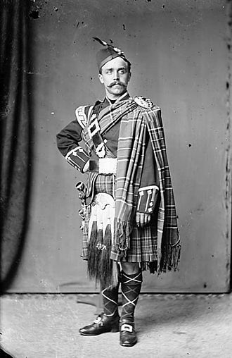 Sporran - A man wearing tartan, including a large sporran (Russell) NLW3363120