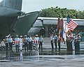A multi-service honor guard carries caskets containing the remains of 24 service members recovered from the Vietnam and Korea War during a repatriation ceremony on Hickam Air Force Base, Hawaii 011005-N-JW822-001.jpg