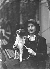 A schoolgirl exhibitor with her dog, c. 1930, by Sam Hood (6286945463).jpg