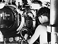A submariner at the controls of a Royal Navy midget submarine in Sydney, Australia, 1945. A30570.jpg