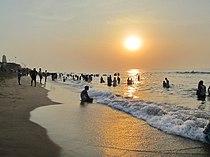 A tourist enjoy the sunrise, Tiruchendur, India.jpg