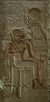 Isis holds Pharaoh Seti I in her lap.