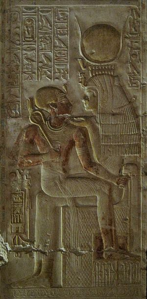 Ancient Egyptian deities - Isis, a mother goddess and a patroness of kingship, holds Pharaoh Seti I in her lap.
