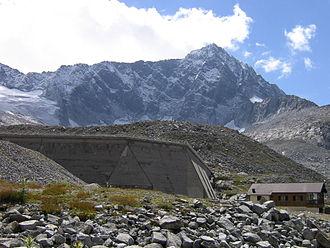 Adamello-Presanella Alps - Mount Adamello's North face with Venerocolo dam in the foreground