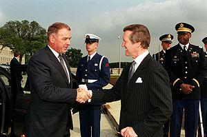 Adolf Ogi - Ogi (left) greets William Cohen, then Secretary of Defence of the United States.