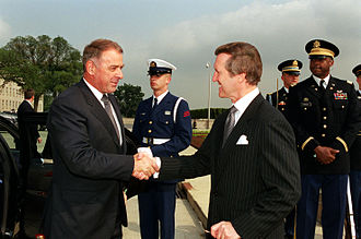 Adolf Ogi - Ogi (left) greets William Cohen, then Secretary of Defence of the United States.