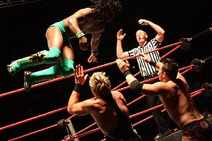 Kofi Kingston - Kingston in a match against Jack Swagger and The Miz