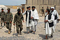 Afghan National Army soldiers escort Haji Faizal Mohammad, center, the governor of the Panjwai district of Kandahar province, Afghanistan, and other Afghan government officials after an agricultural shura, or 130328-A-ZZ999-655.jpg