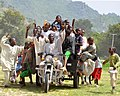 Ali converted his forefathers motor cycle to a tricycle to aid Santuraki Adamawa transportation in 2004.jpg